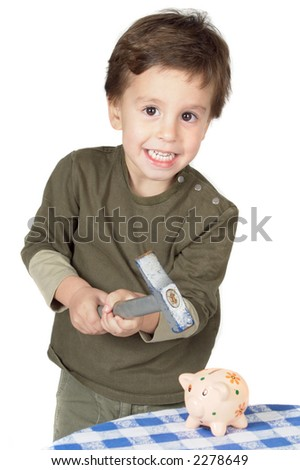 photo of an adorable boy breaking the money-box