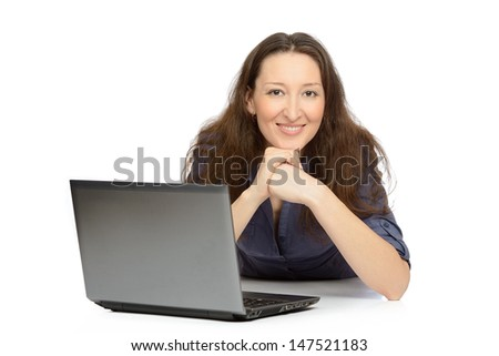 Photo of an attractive young woman at work on her laptop computer.