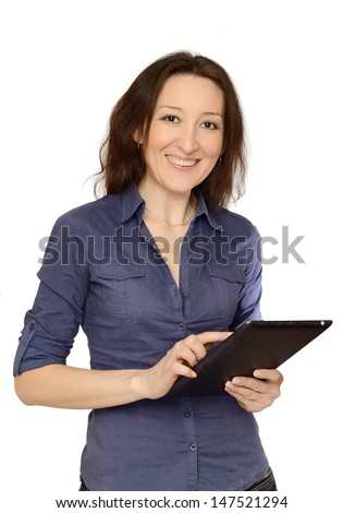 Photo of an attractive young woman at work on her  Tablet PC.