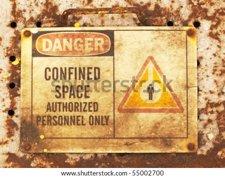photo of an old confined space sign