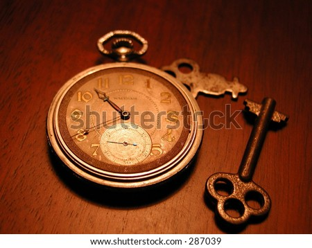 Photo of an old watch, keys, and money.