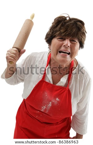 Photo of an old woman angry and threatening with a rolling pin.