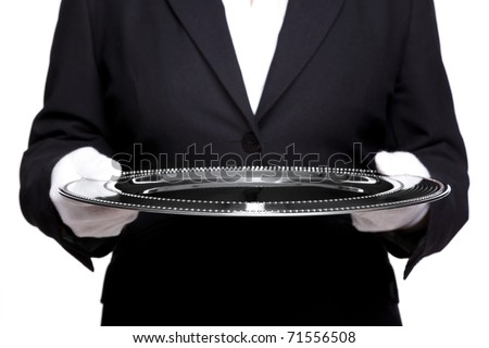Photo of an unreconisable female butler holding a silver tray, isolated against a white background. Focus is on the front of the tray, good image for product placement. ストックフォト ©