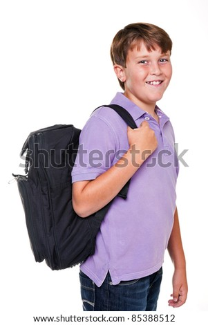 Photo of an 11 year old school boy carrying his school rucksack bag, isolated on a white background.