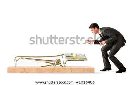 Photo of attentive businessman standing by mouse trap and looking at money