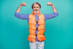 Photo of attractive aged guy show two biceps arms strong mariner sea ocean ship trip sportsman wear striped sailor shirt shorts orange vest isolated teal color background