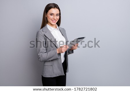 Photo of attractive business lady confident manager worker use modern technology digital tablet work remote distance wear specs shirt plaid blazer isolated grey color background