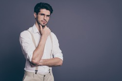 Photo of attractive business man charming appearance holding arm on chin deep minded dressed formalwear white shirt beige suspenders specs isolated grey color background
