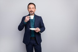 Photo of attractive business mature man elegant look manager boss drinking morning coffee smell nice aroma formalwear shirt pants blazer blue suit isolated grey color background