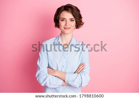 Photo of attractive charming business lady smiling hold arms hands crossed good mood self-confident successful worker person wear blue shirt isolated pink color background
