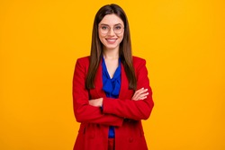 Photo of attractive confident bossy business lady hold arms crossed toothy smiling friendly partner wear specs red luxury office blazer suit isolated yellow bright color background