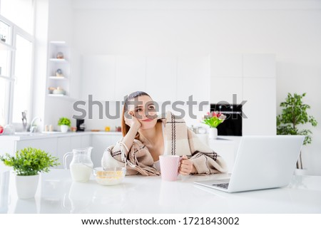 Photo of attractive homey housewife lady covered blanket morning lazy worker have breakfast drink coffee not interested working dreamy look up stay home quarantine time remote worker indoors