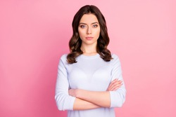 Photo of attractive pretty lady not smiling self-confident business woman arms crossed bossy look wear casual white pullover isolated pink color background