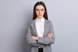 Photo of attractive strict business lady not smiling self-confident bossy manager worker arms crossed wear specs white shirt checkered blazer isolated grey color background