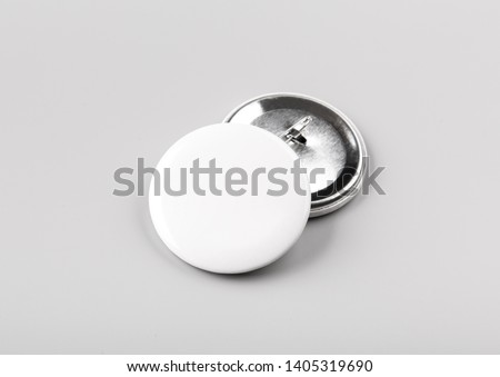 Photo of badge. Template for branding identity. For graphic designers presentations and portfolios. Badge Mock-up isolated on gray background. Photo mock up.