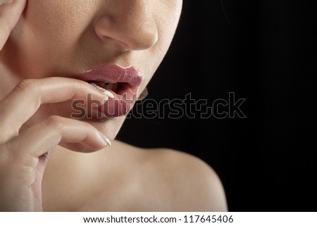 Photo of beautiful female lips and fingers