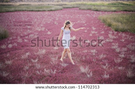 Photo of beautiful girl dancing at field