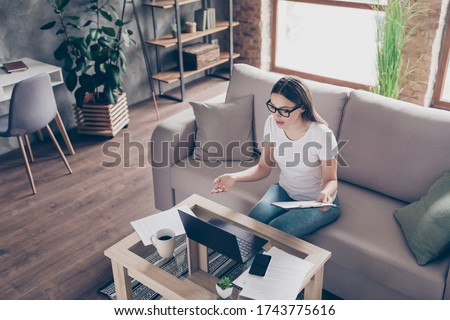 Photo of beautiful lady hr worker talking skype online check vacancy candidate ask questions watch read resume working house quarantine time study home sit couch living room indoors