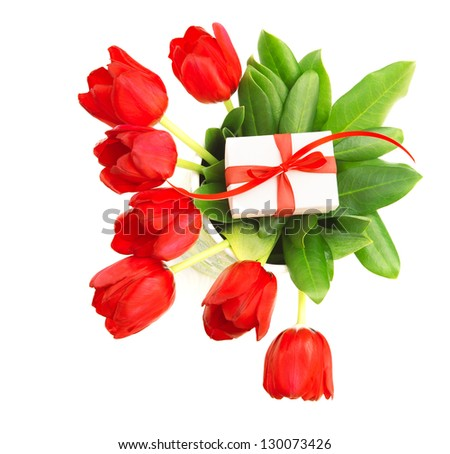 Photo of beautiful red tulips bouquet with small giftbox on green leaves of flowers isolated on white background, happy mothers day, anniversary celebration, romantic gift, love concept