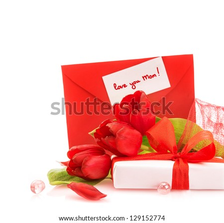 Photo of beautiful romantic still life for mothers day, fresh red tulips, gift box, holiday greeting card, festive border, copy space, present for mom, floral bouquet, spring season, love concept