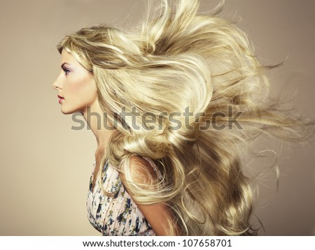 Stock Photo Photo of beautiful woman with magnificent hair. Fashion photo
