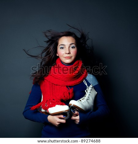 Photo of beautiful woman with magnificent hair. Pretty young girl with the skates