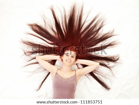 photo of beautiful woman with magnificent hair, white background