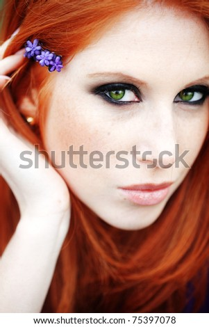 Photo of beautiful woman with red hair