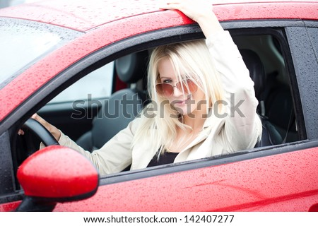 Photo Of Beautiful Woman With Sunglasses On A Rainy Day.