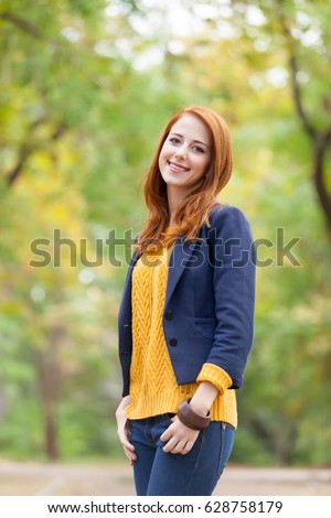 photo of beautiful young woman on the wonderful autumn park background