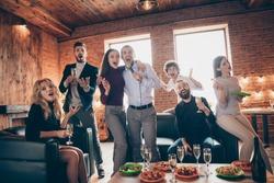 Photo of best amazing friends celebrating birthday party singing karaoke songs hold microphone drink golden wine eat snack food wear formalwear sitting sofa restaurant indoors