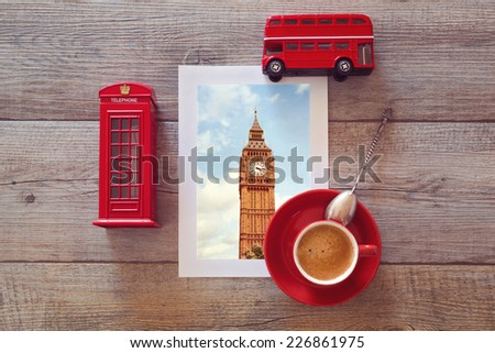 Photo of Big Ben in London on wooden table with coffee cup and souvenirs