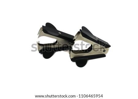 Photo of black anti-stapler isolated on white background.