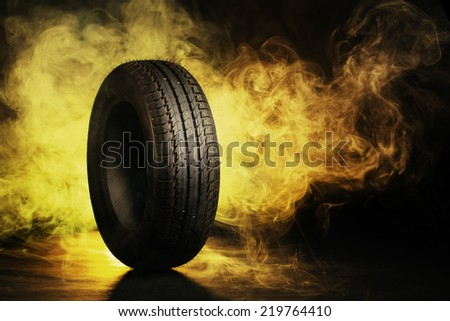 photo of black smoked and burning tire