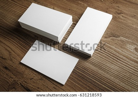 Photo of blank business cards on a wooden table background. Template for ID. #631218593