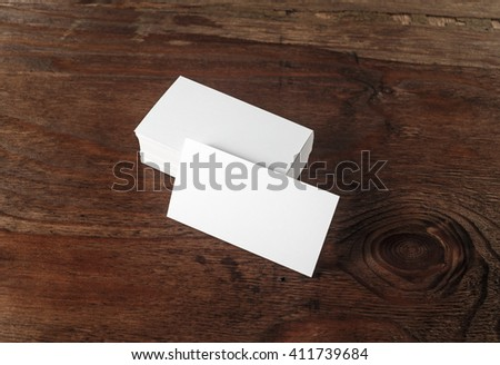 photo of blank business cards on dark brown wooden background blank