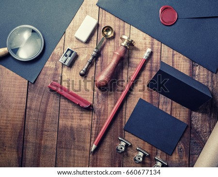 Photo of blank corporate identity. Black vintage stationery set on vintage wood background. Branding mockup. Blank objects for placing your design.