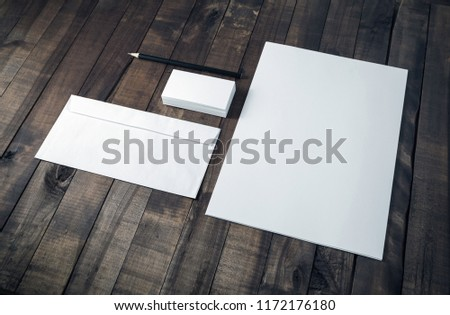 Photo of blank corporate stationery set on wood table background. #1172176180