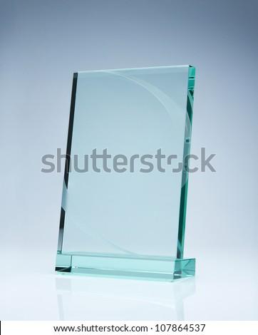 Photo of blank glass award plate with copy space