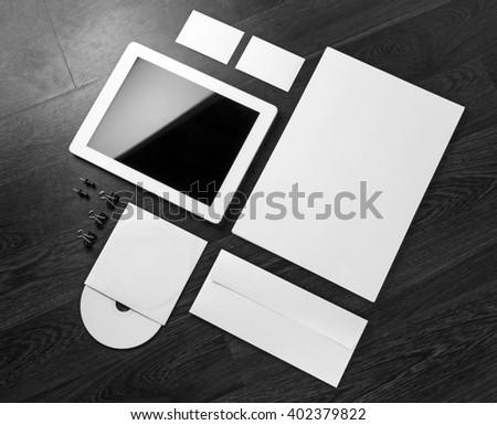 Photo of blank stationery and corporate identity template on dark wooden background. For design presentations and portfolios. #402379822