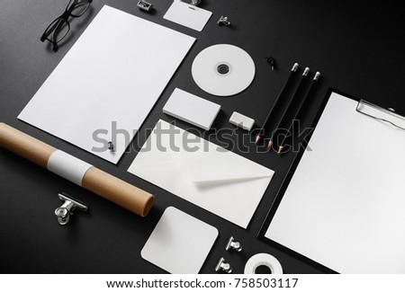 Photo of blank stationery set on black paper background. Corporate identity mockup. Responsive design template. #758503117