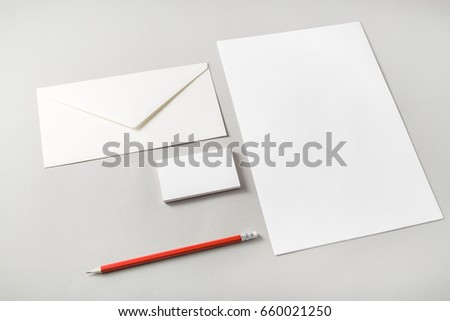 Photo of blank stationery set on paper background. Letterhead, business cards, envelope and pencil. Template for placing your design. Top view. #660021250