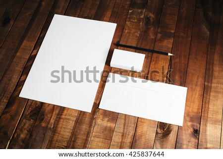 Photo of blank stationery set on vintage wooden table background. Blank ID template. Mock-up for branding identity. Letterhead, business cards, envelope and pencil. #425837644