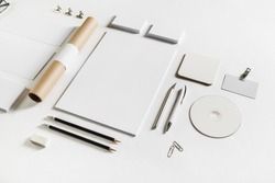 Photo of blank stationery set on white paper background. Corporate identity mockup. Responsive design template.