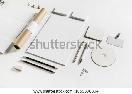 Photo of blank stationery set on white paper background. Corporate identity mockup. Responsive design template. #1055398304