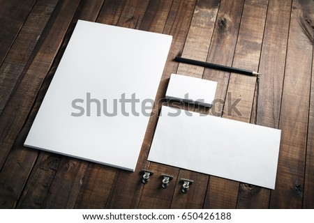 Photo of blank stationery set on wood background. Envelope, business cards, pencil, and A4 paper. Corporate identity template. Responsive design mockup. #650426188