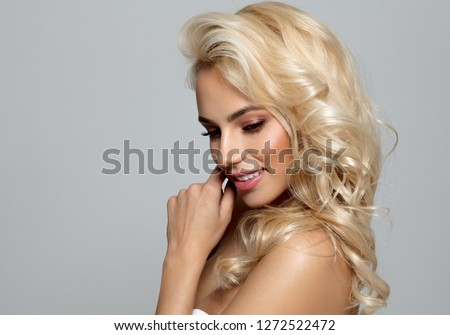 Photo of blond female model looking down #1272522472