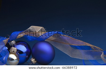 Photo of blue Christmas balls on a blue background