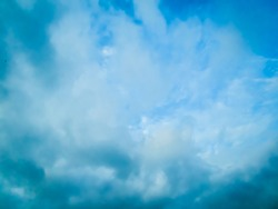 Photo of blue sky surrounded by dramatic clouds during daytime