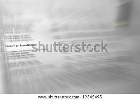 "Photo of blurred financial spreadsheet with ""return on investment"" in focus"